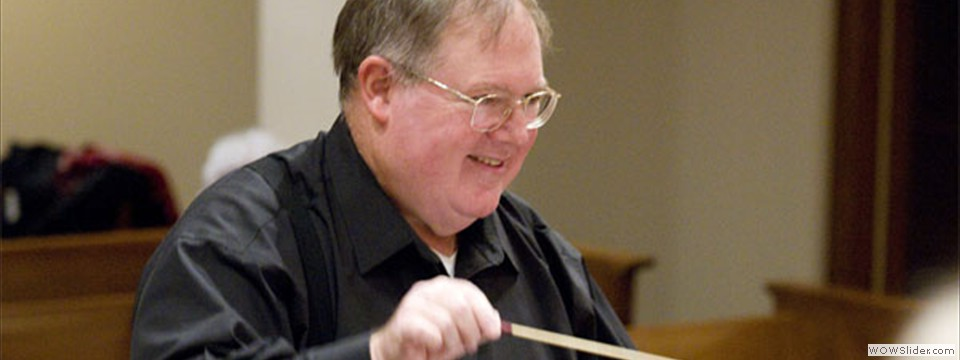 Close up of Bob Webb conducting.