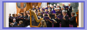 The Northern Virginia Chorale performs, We Remember Them with orchestra, and harpist at center of photo